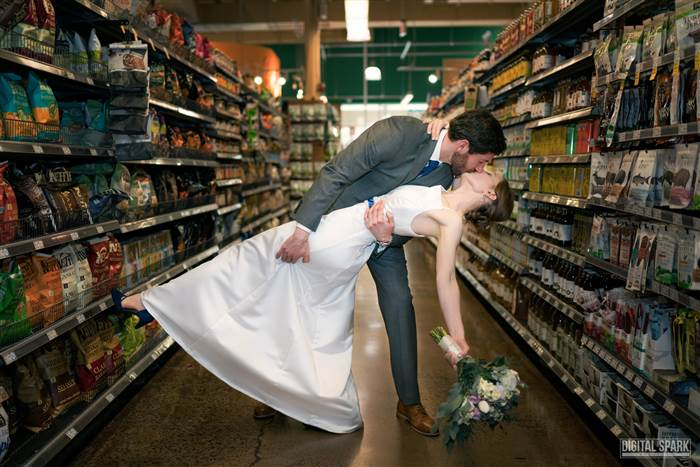 Couple holds dream wedding in the flower department at local grocery store